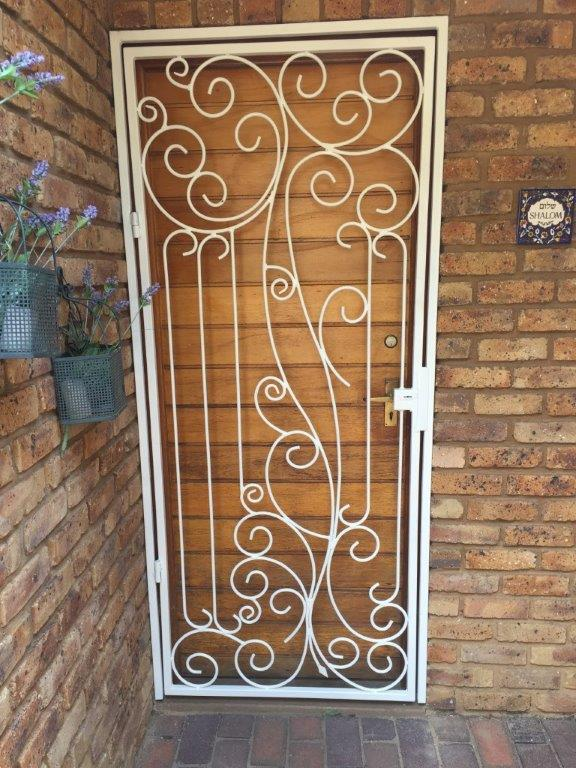 Beautiful steel security gate by Exclusivio Wrought Iron Designs