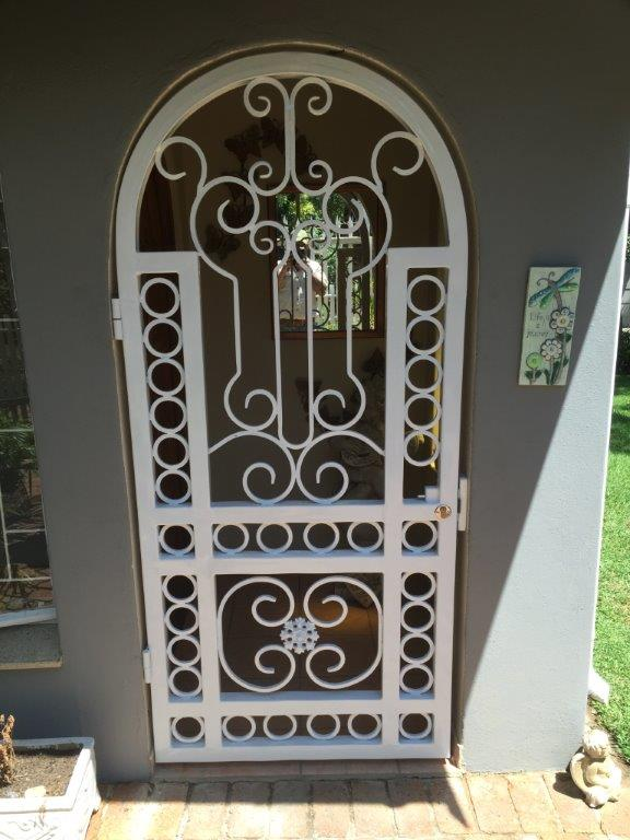 Sturdy looking steel security gate by Exclusivio Wrough Iron Designs